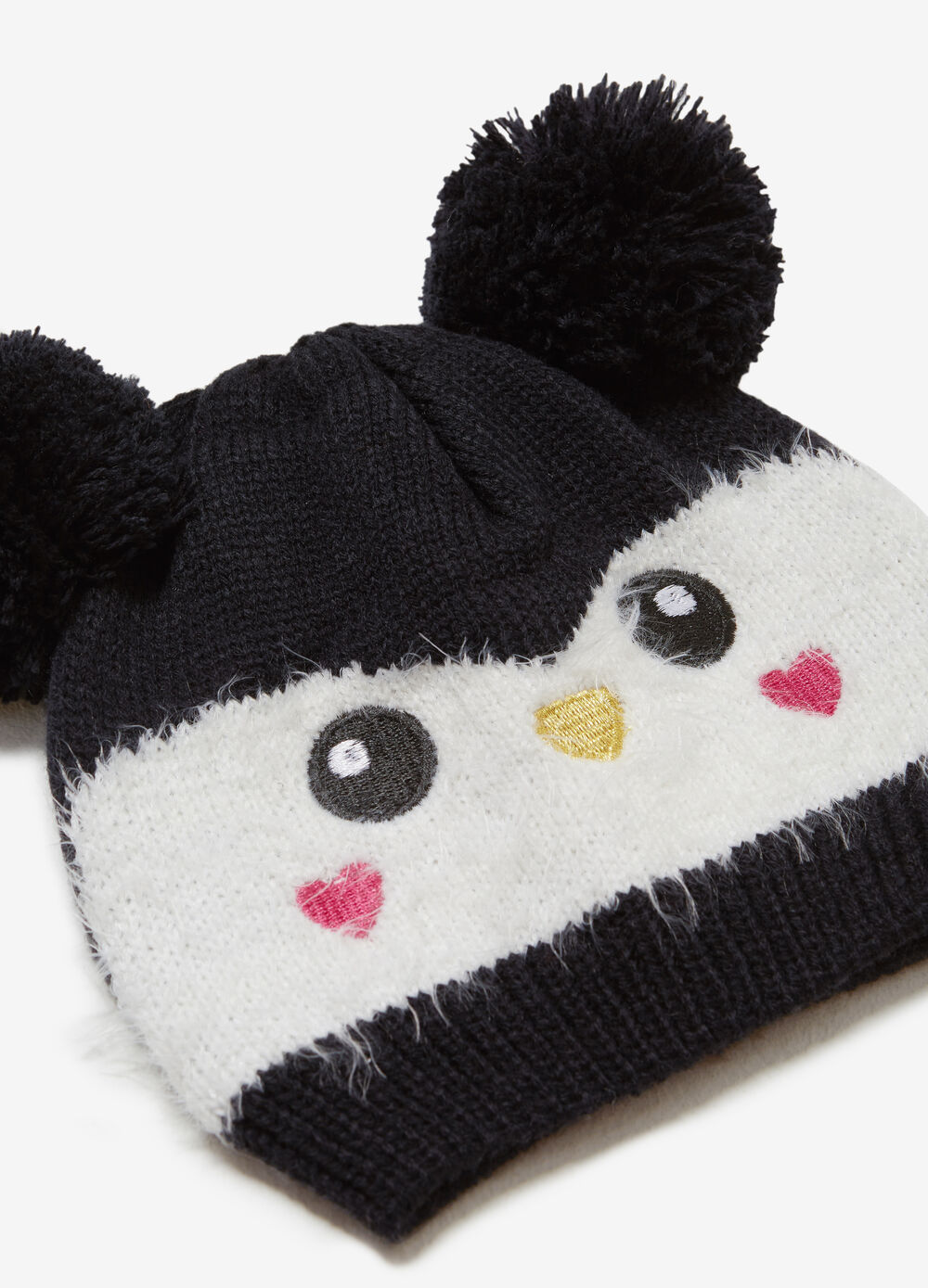 Embroidered beanie cap with pompoms