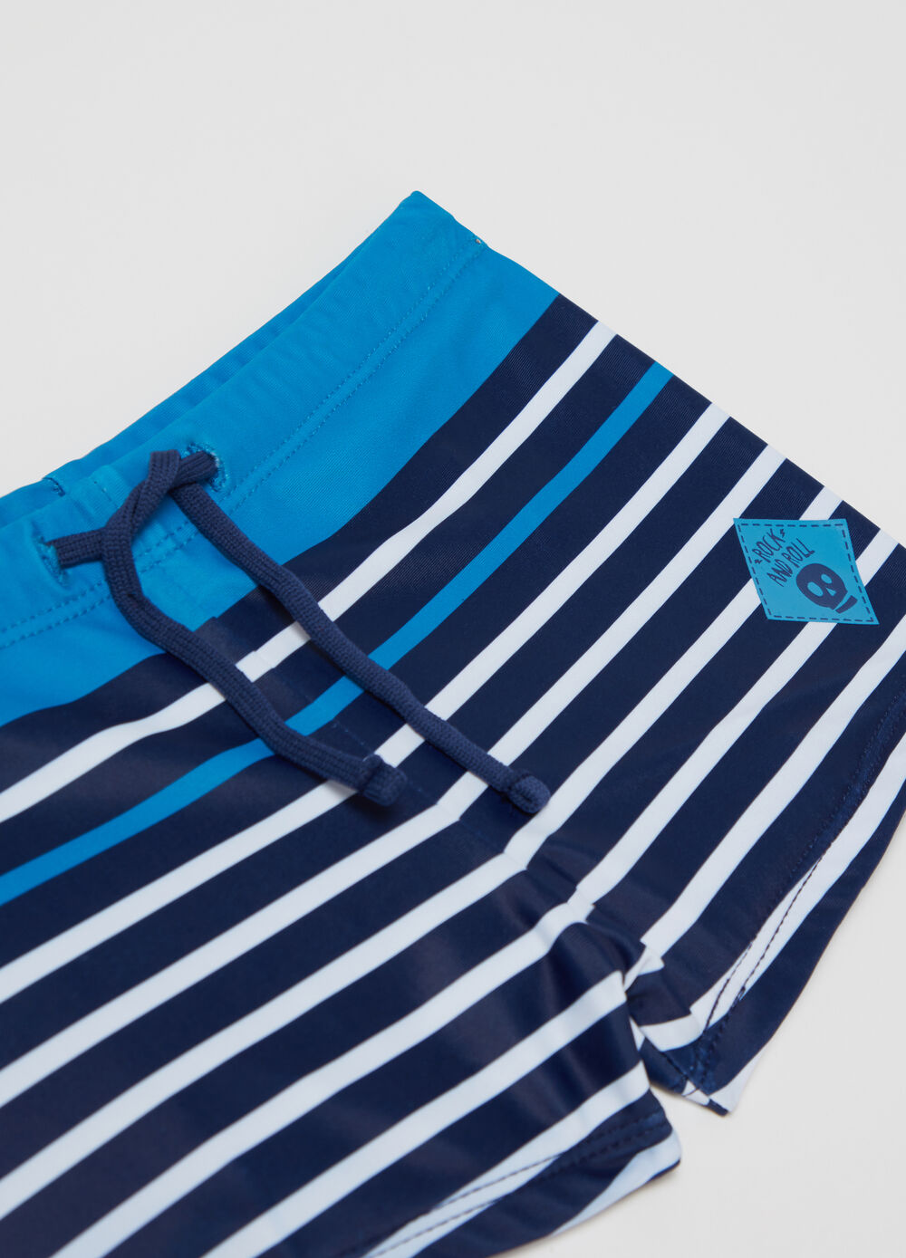 Swim trunks with skull print and striped pattern