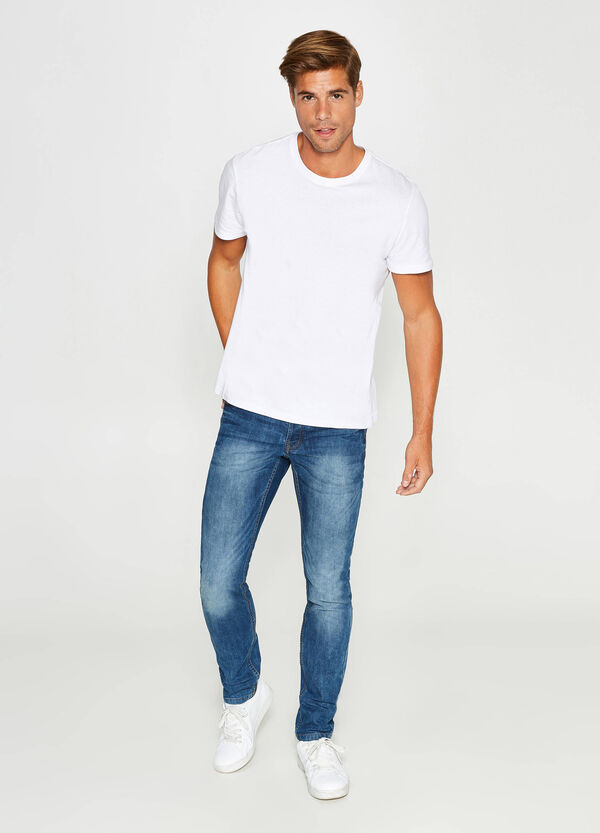 Washed-effect, slim-fit, misdyed stretch jeans | OVS