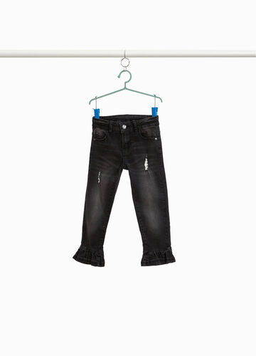 Worn-effect stretch jeans with flounces
