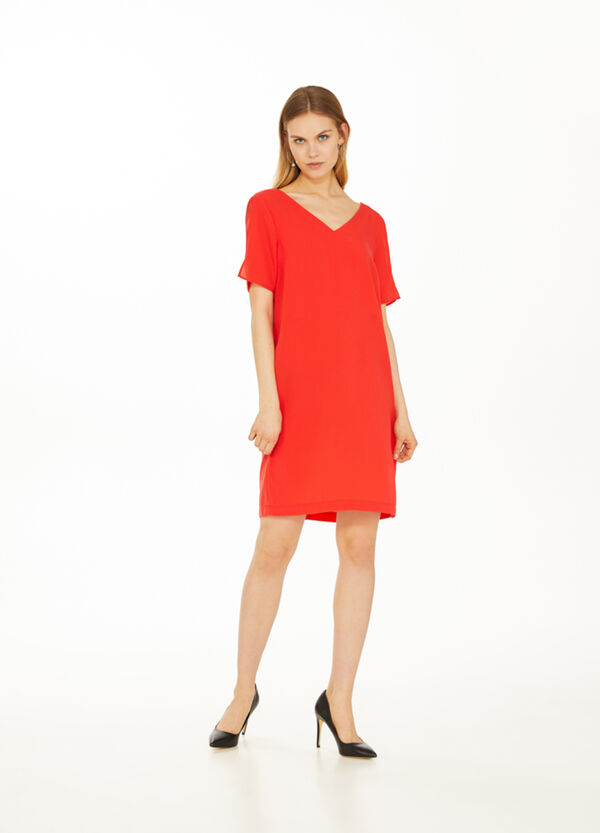 Solid colour stretch dress with openings