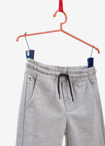 Trousers with drawstring and patch