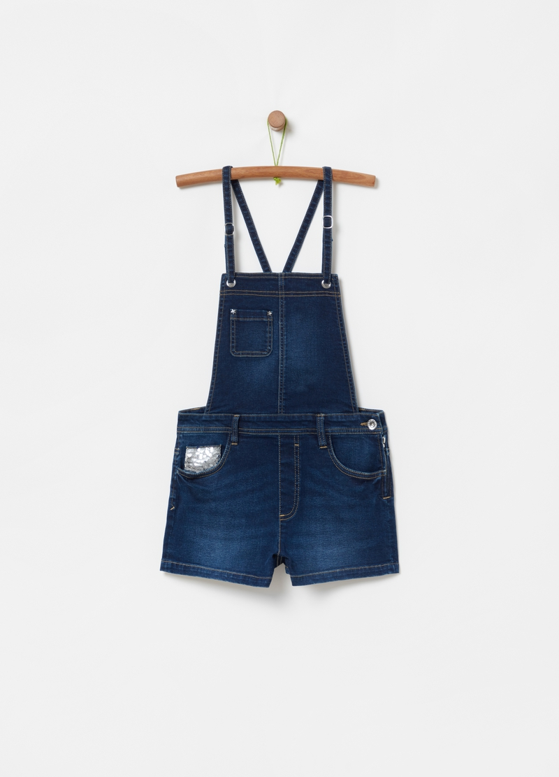 Short dungarees in denim with zip image number null