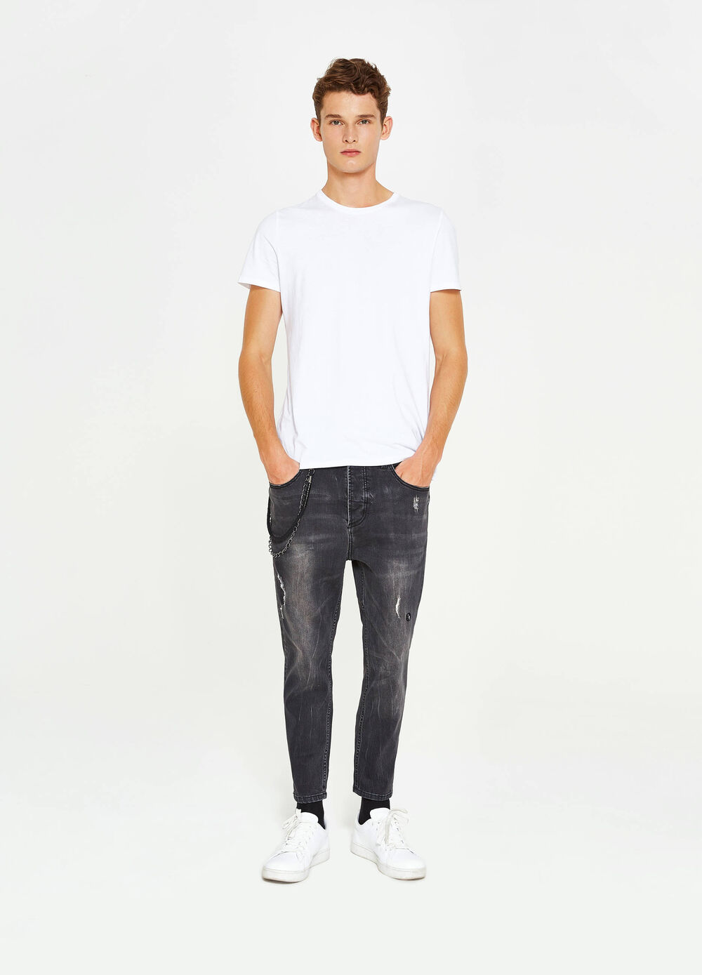 Used-effect stretch jeans with chain