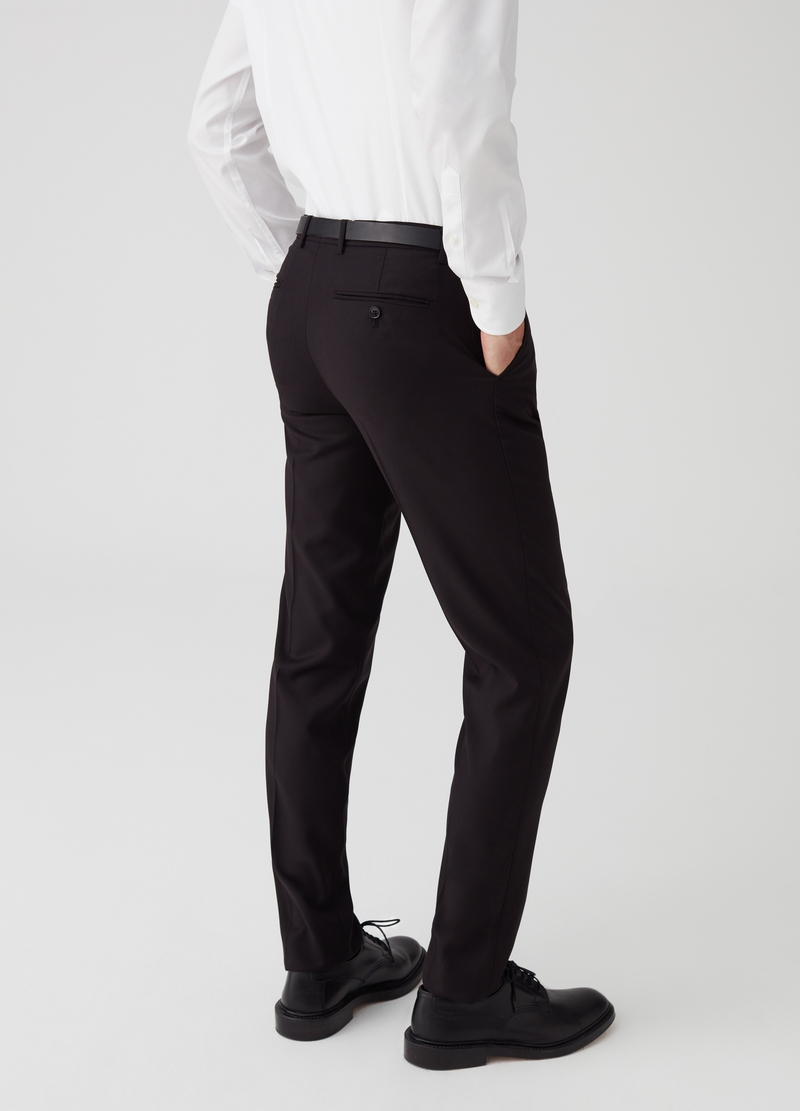 Pantaloni stretch con piega centrale image number null