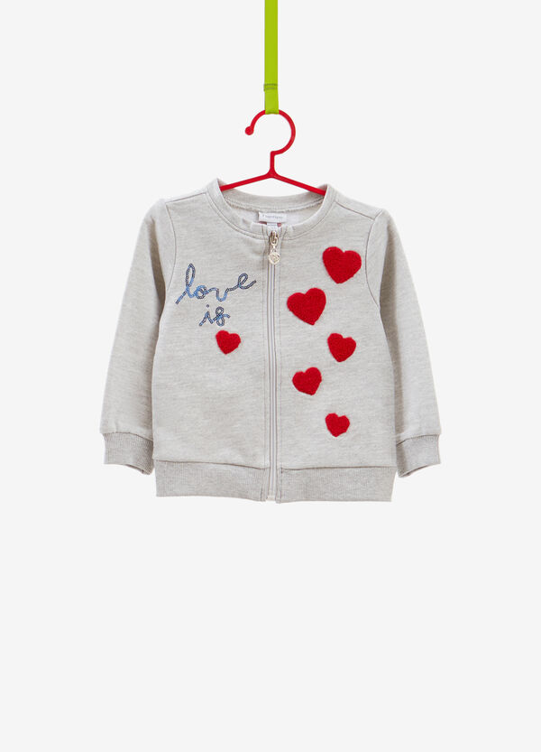 Sweatshirt with sequins and hearts patches