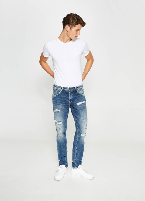 Jeans straight fit stretch con strappi | OVS