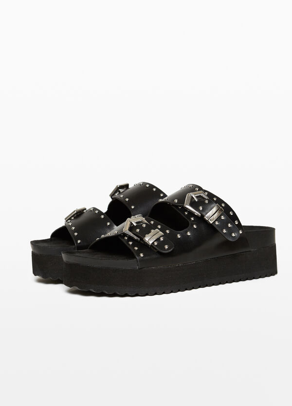 Sandals with studs and thick sole