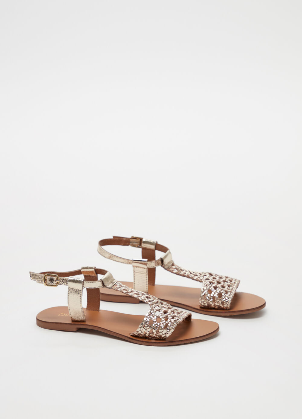 Sandals with polished-effect openwork strap