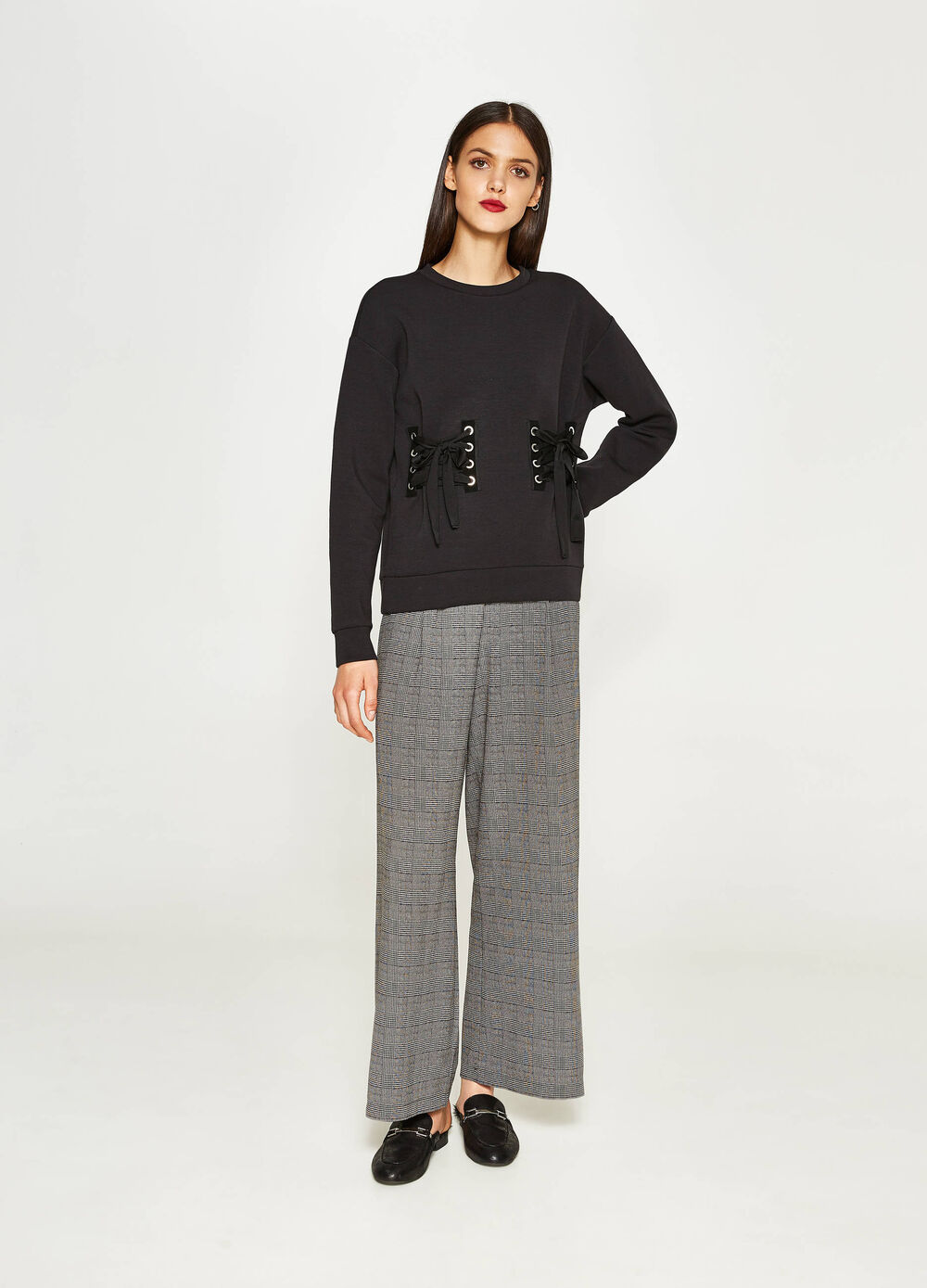 Stretch palazzo trousers with tartan pattern