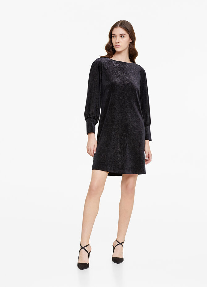 Dress with long sleeves and openings