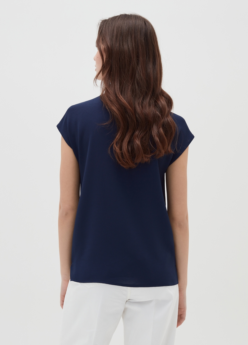 Blouse with cap sleeves and detail on the neckline image number null