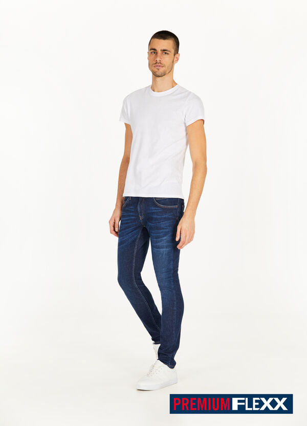 Jeans slim fit baffature e scoloriture