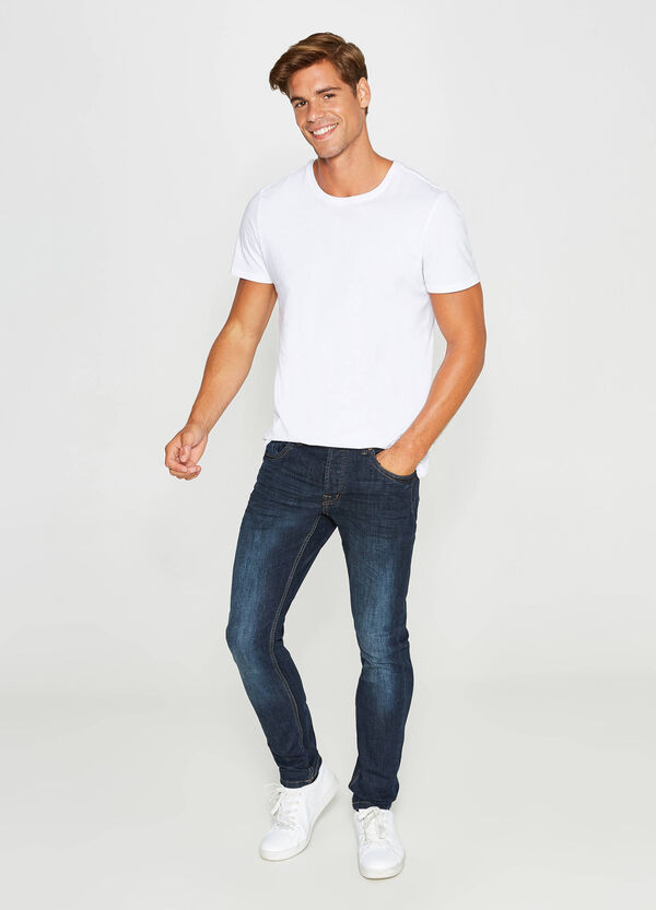 Worn-effect slim-fit stretch jeans with fading | OVS