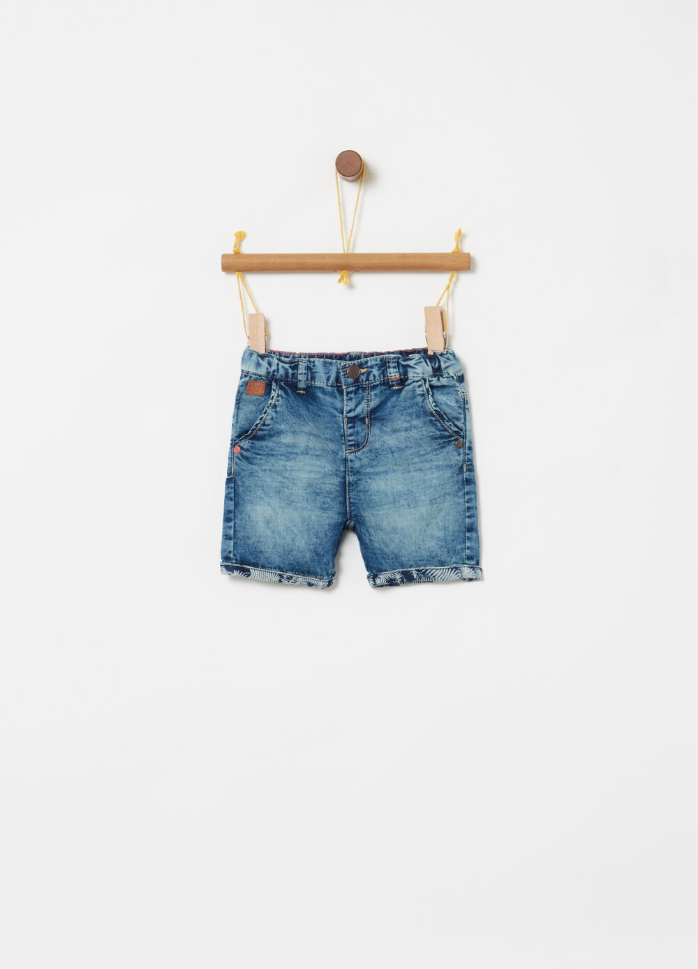 Washed denim Bermuda shorts with pockets