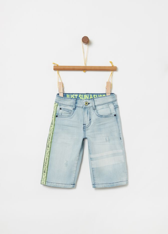 Stretch denim shorts with decorative sash