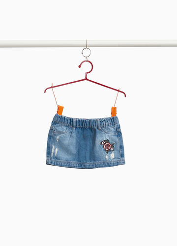 Denim skirt with patch and abrasions