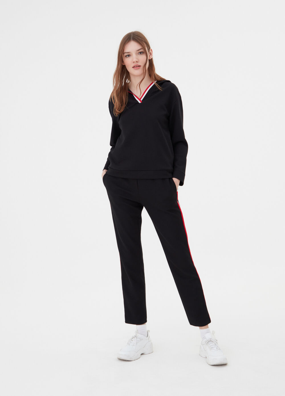 Trousers with contrasting bands on the sides
