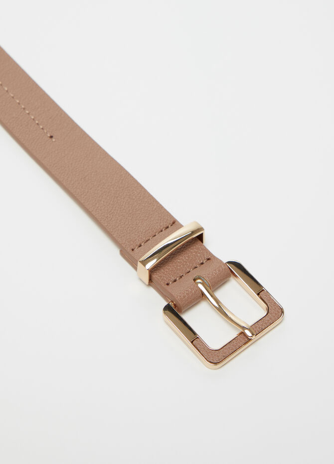 Belt with metal buckle and insert