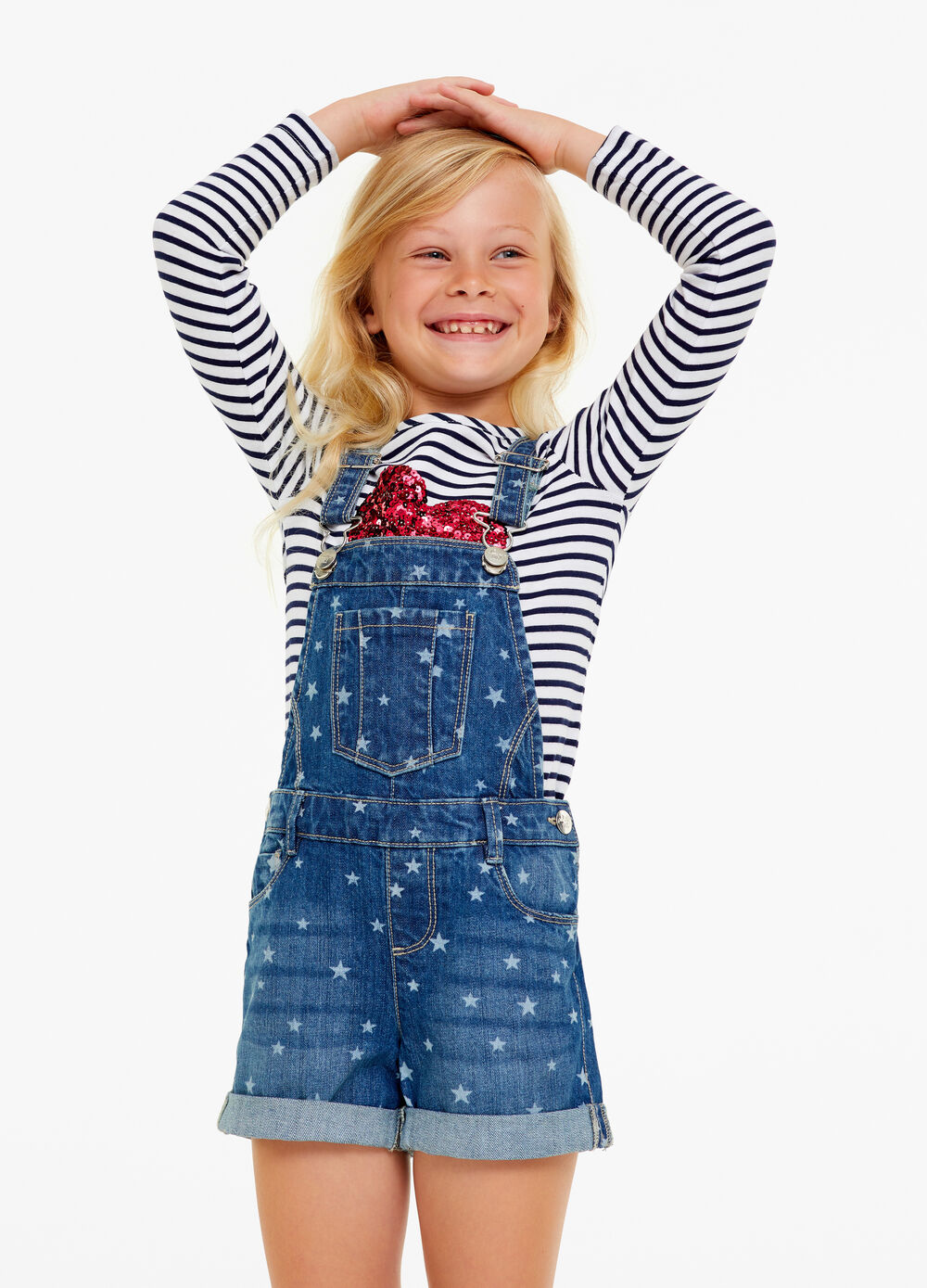 Worn denim dungarees with stars