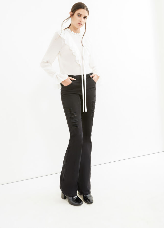 Solid colour stretch jeans with rips
