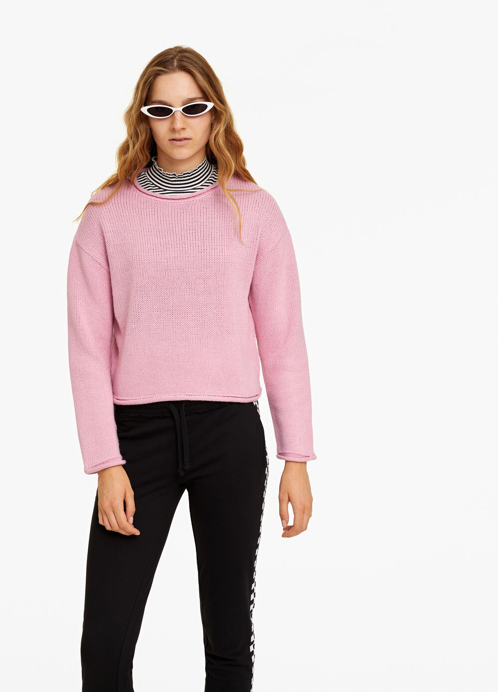 Knitted crop pullover with roll-up edges