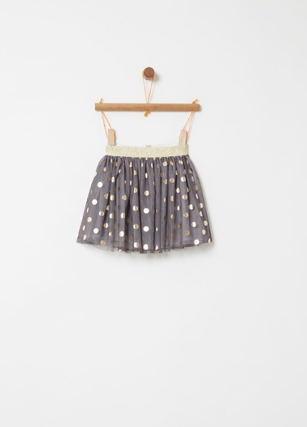 Tulle skirt with laminated gold polka dot pattern
