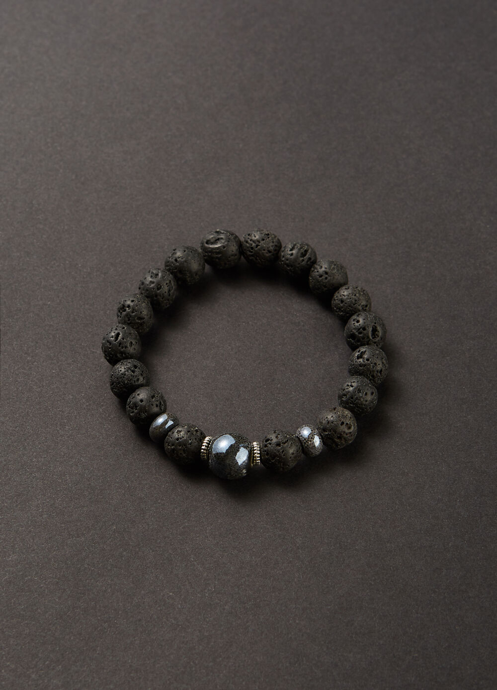 Bracelet with engraved stone beads