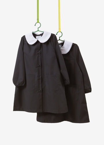 Set of two smocks in cotton with trim.