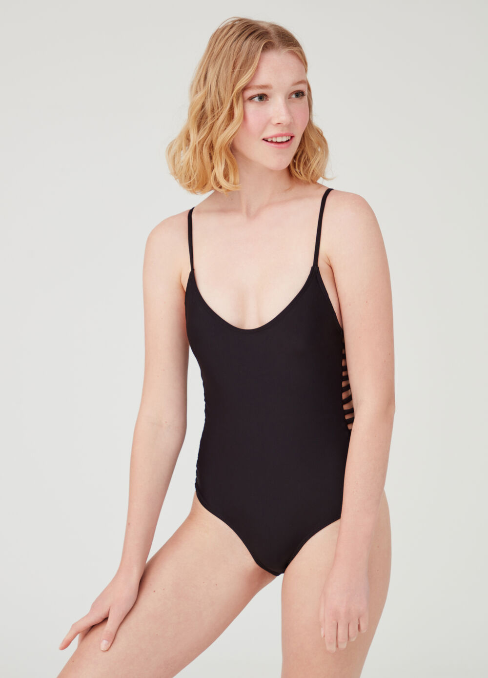 One-piece stretch swimsuit with openings