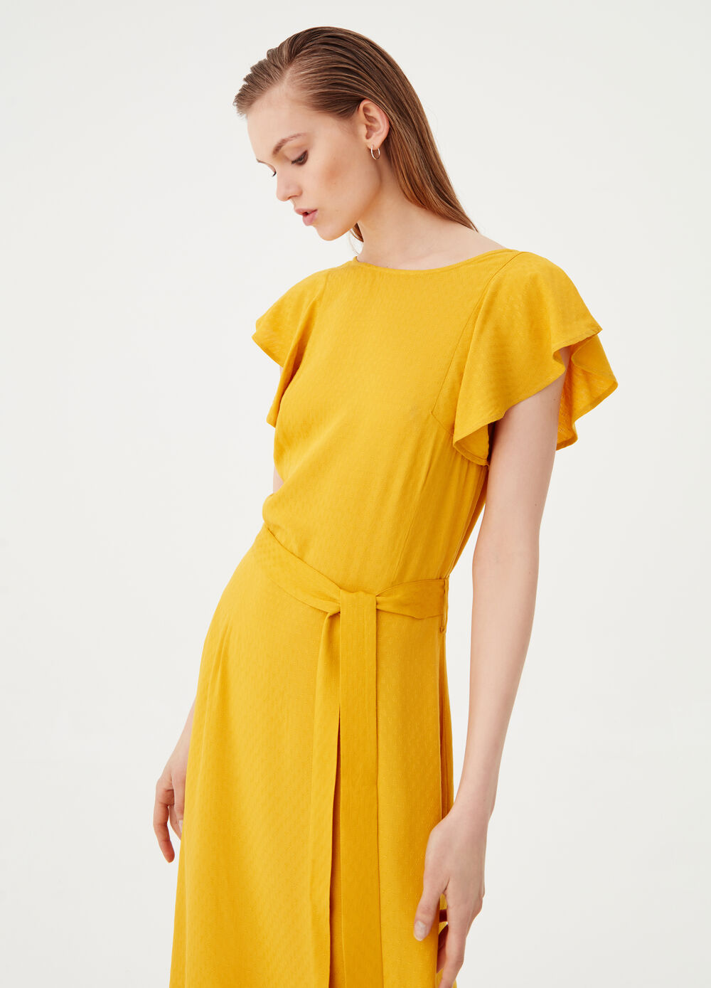 Asymmetric dress with flounces and belt