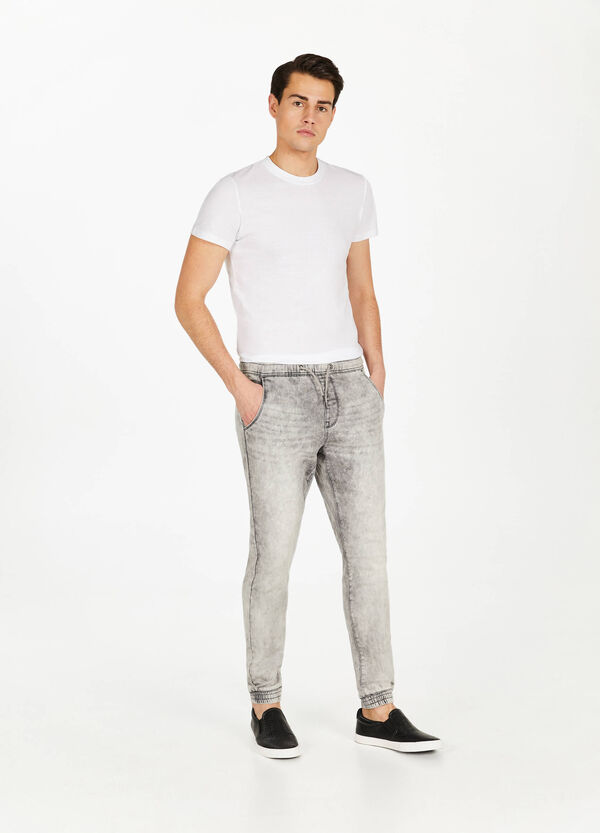 Worn-effect jogger-fit stretch jeans
