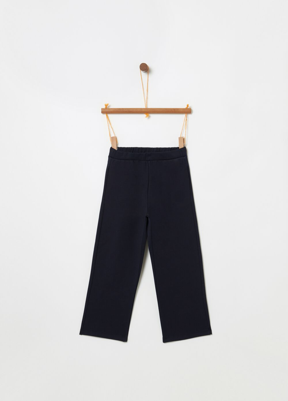 Solid colour crop trousers in French terry