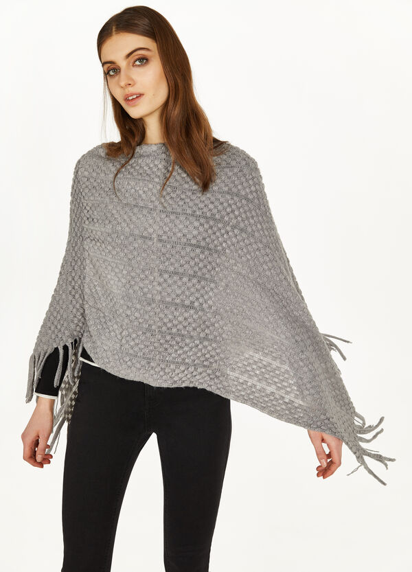 Poncho with knitted motif
