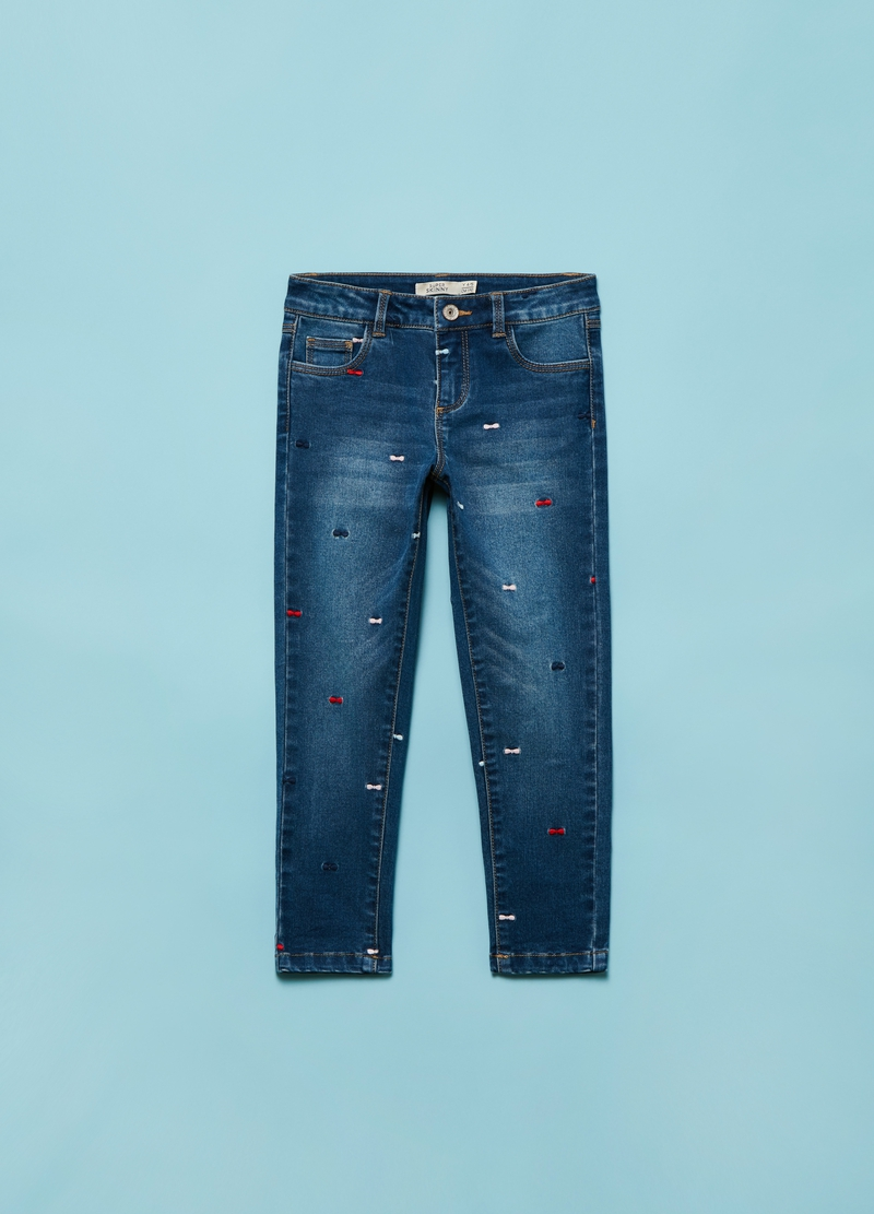 Jeans super skinny con fiocchetti all-over image number null