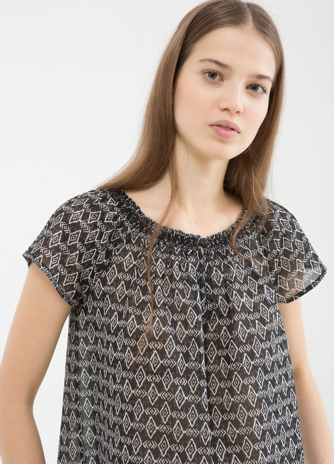 Blouse with patterned ruffle neckline.