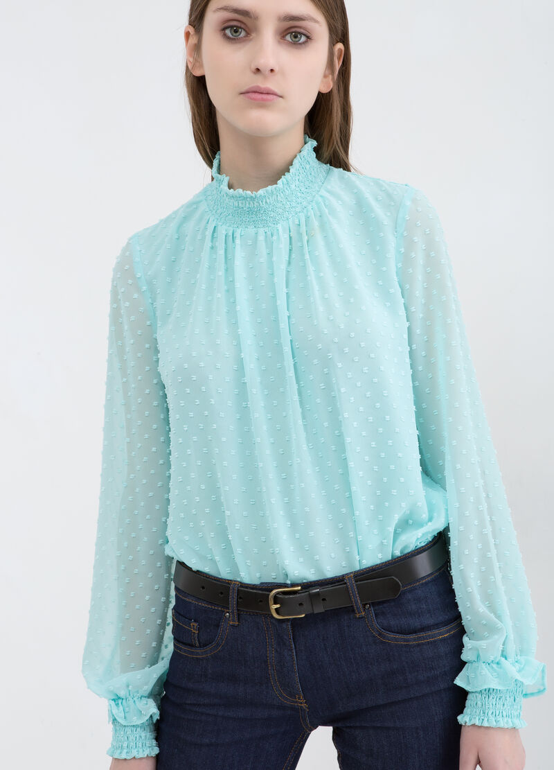 Blouse with high gathered neck.
