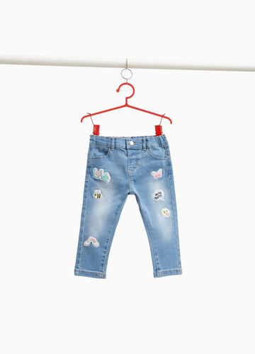 Faded stretch jeans with patches