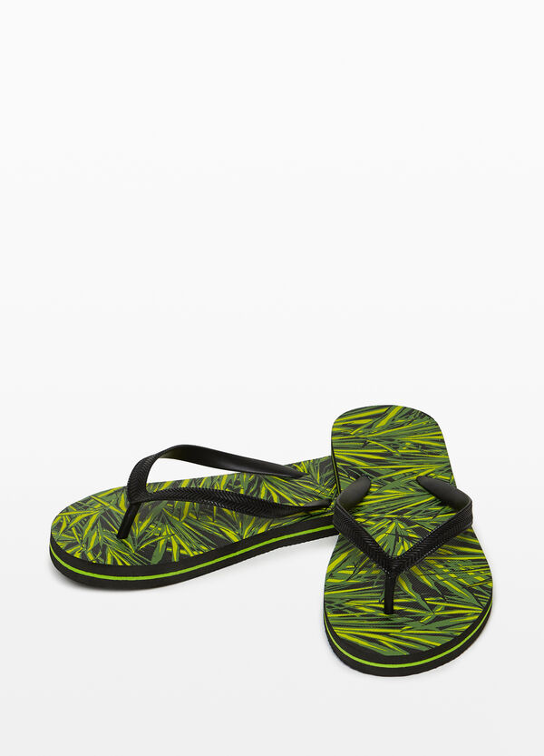 Rubber flip flops with foliage sole