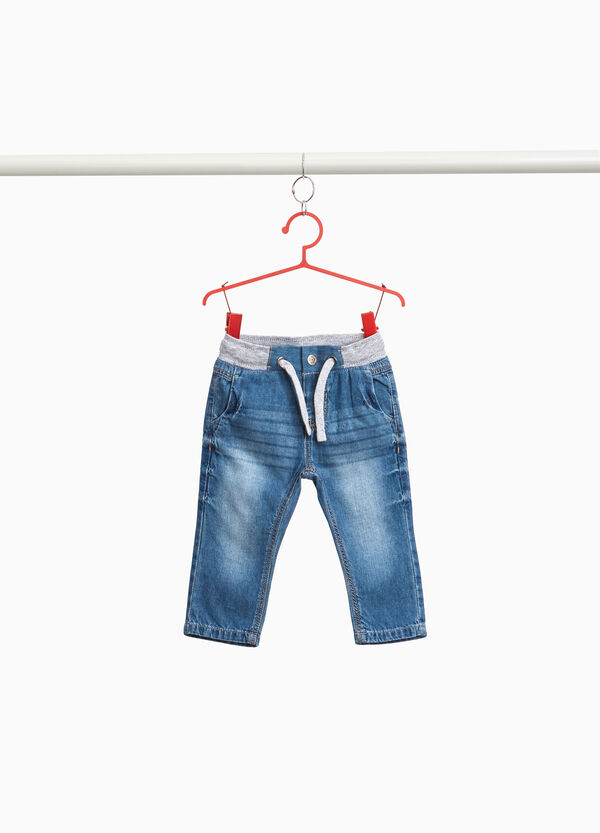Jeans used con baffature e coulisse