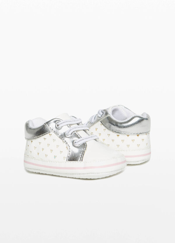 Sneakers with openwork hearts upper