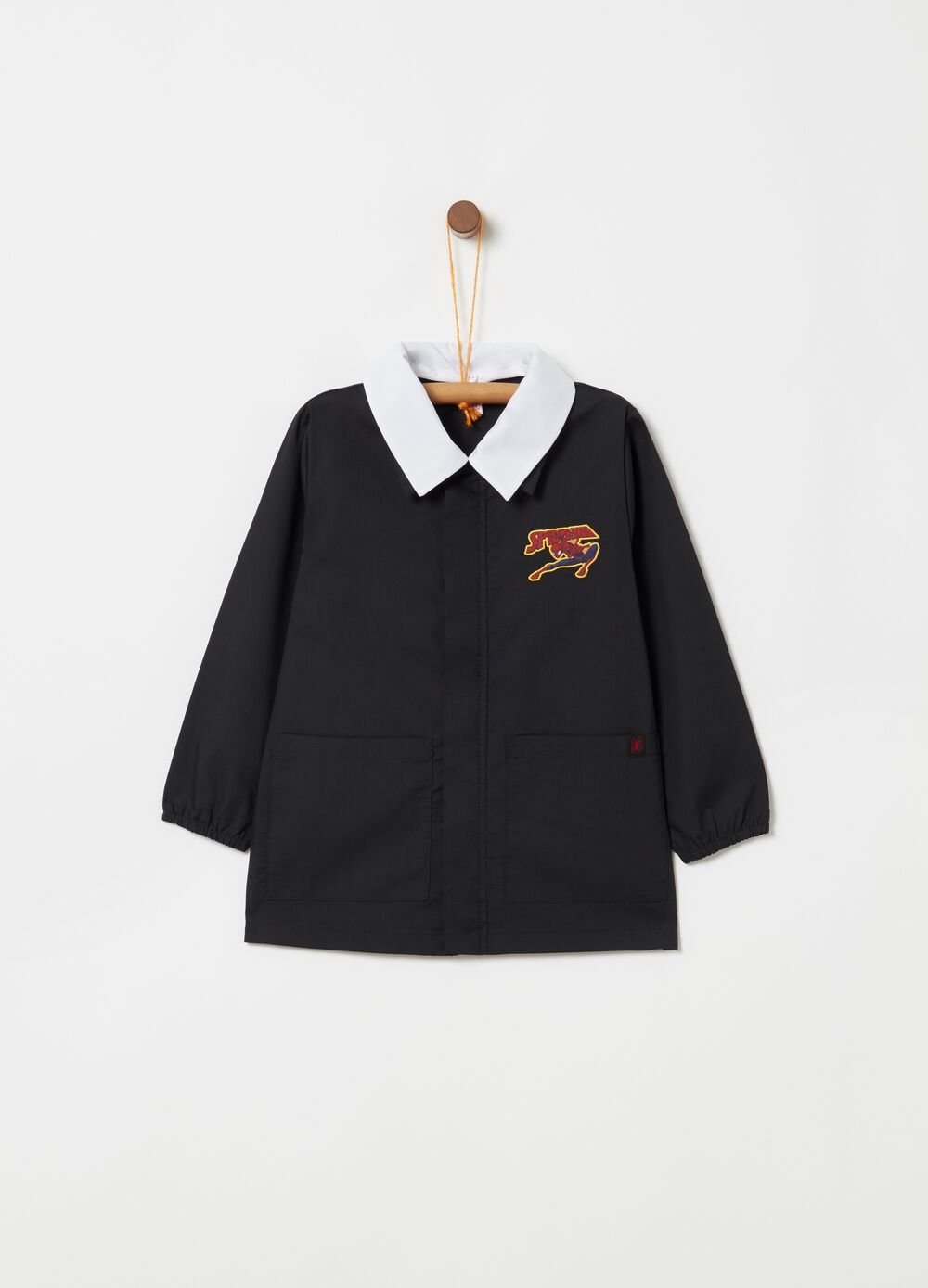 School smock with Spider-Man patch