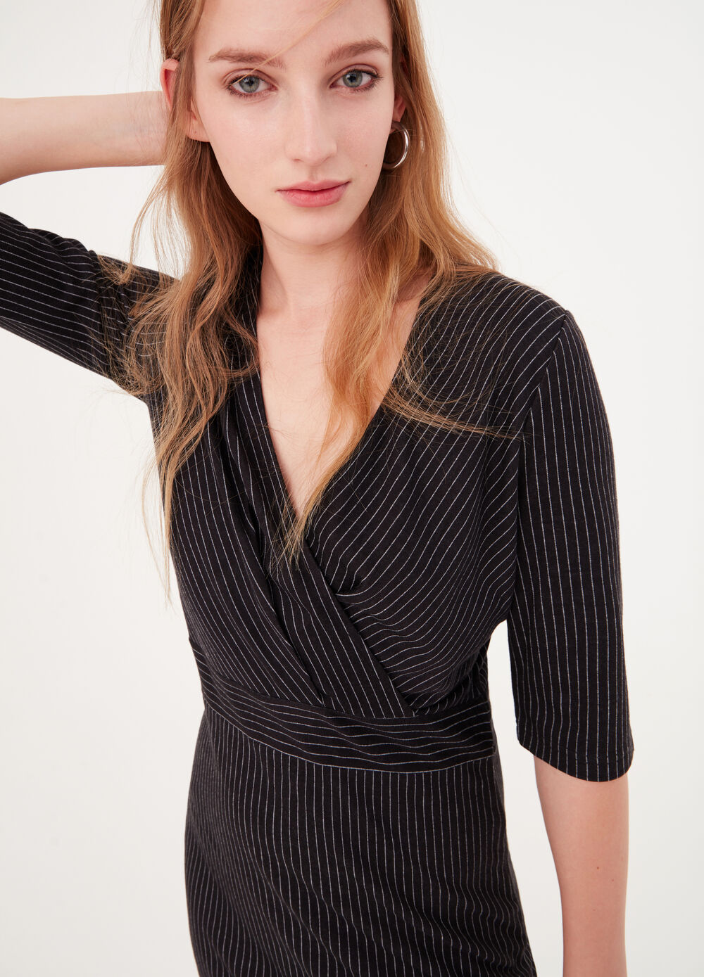 Crossover dress in pinstripe knit fabric