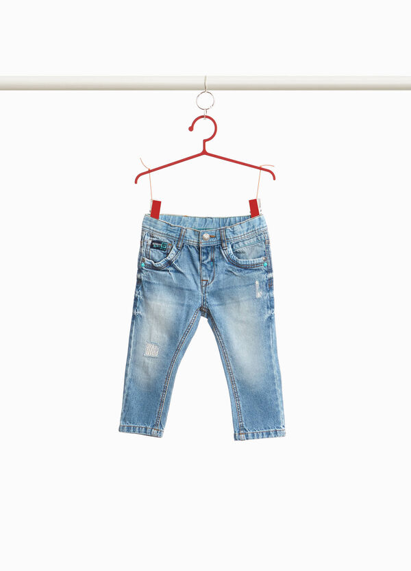 Worn-effect jeans with rips