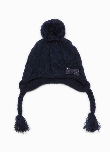 Knitted beanie cap with braids and pompom