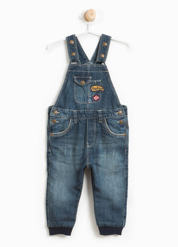 Worn-effect denim dungarees with patches