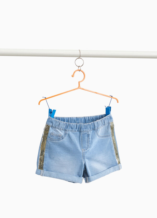 Denim shorts with bands and sequins