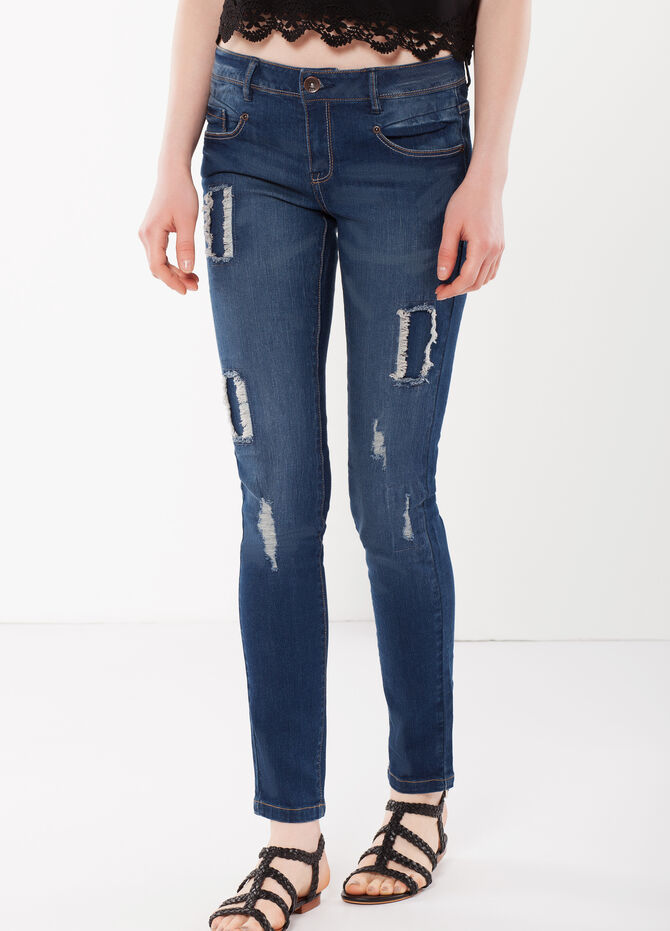 Heavily distressed jeans