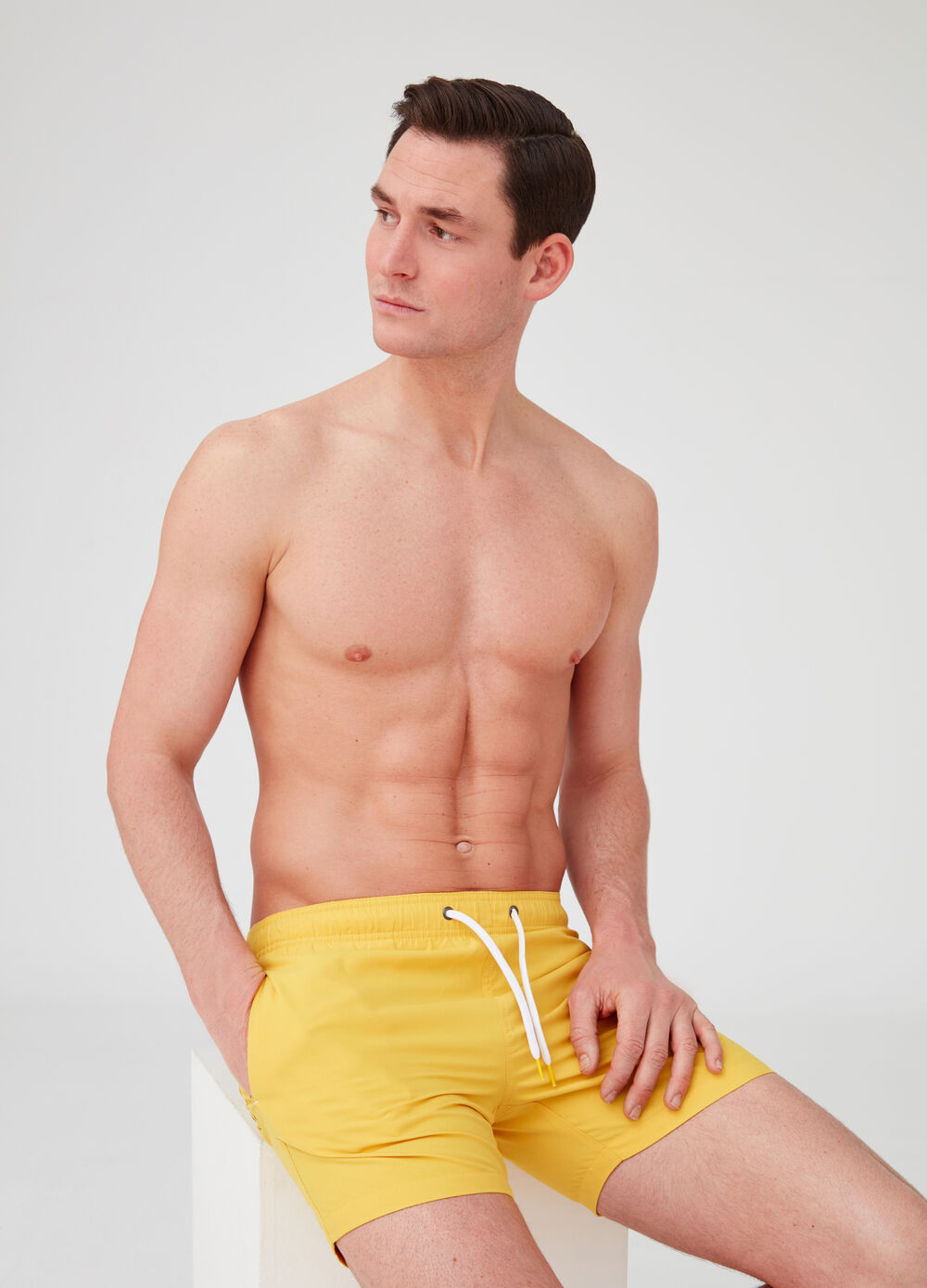 Solid colour swim boxer shorts with pockets