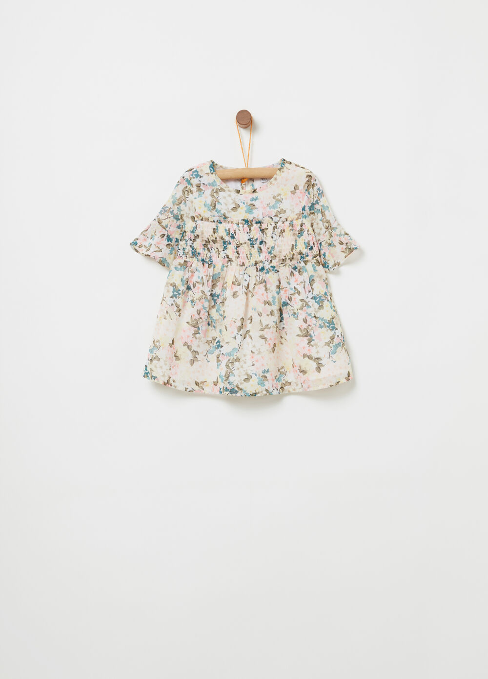Blouse with floral smock-stitch band